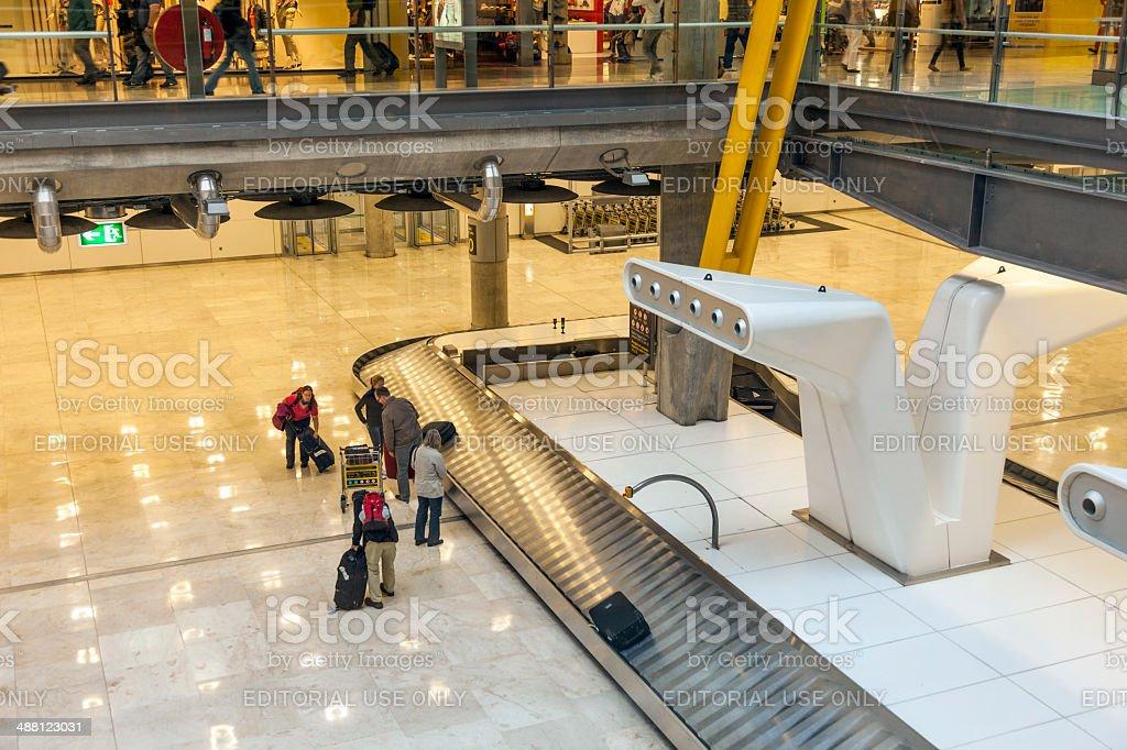 passenger at the beggage belt at Barajay Airport stock photo