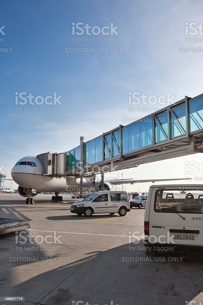 Passenger boarding bridge attached to airplane stock photo