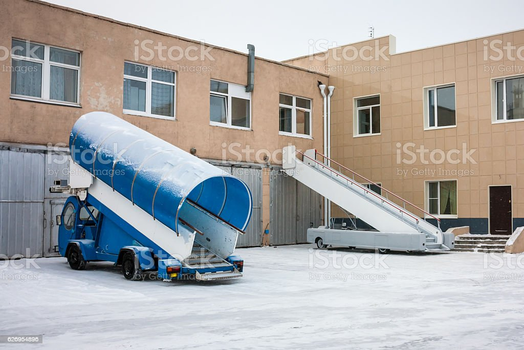 Passenger boarding steps vehicles at the cold winter airport royalty-free stock photo