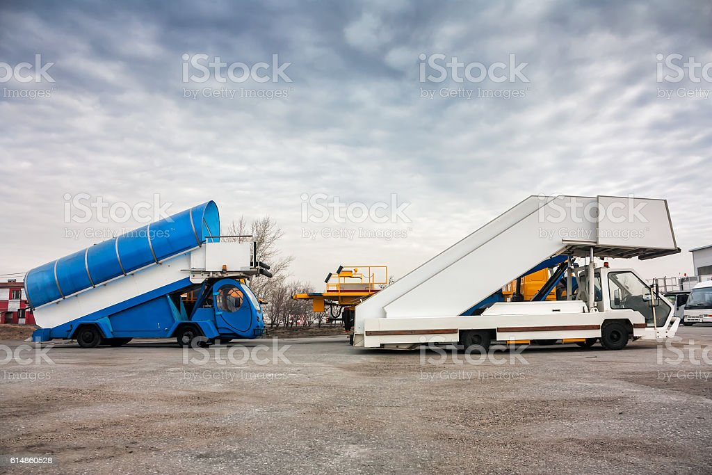 Passenger boarding steps vehicles in the parking airport machinery royalty-free stock photo