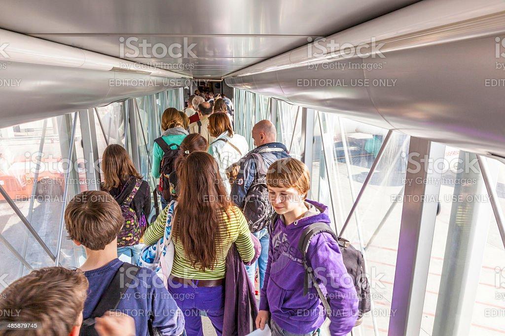 passenger boarding the plane at Terminal 4 stock photo