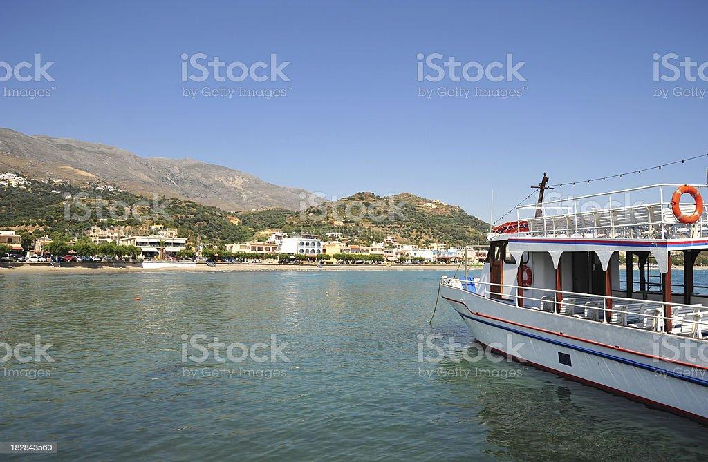 Passenger boat in the harbour at Plakias, Crete, Greece stock photo