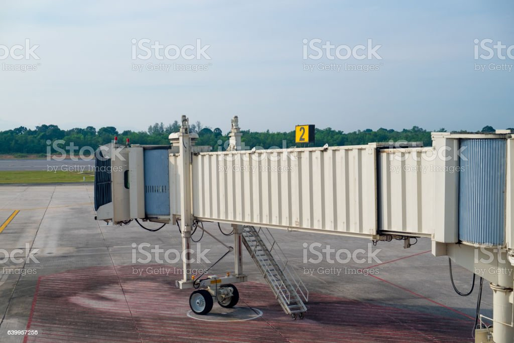 Passenger bridge of aircraft stock photo
