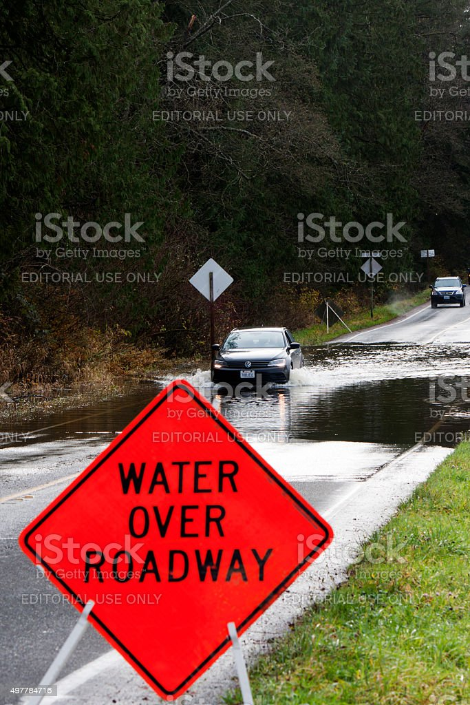 Passenger Car Crossing Flooded Carnation Farm Road stock photo