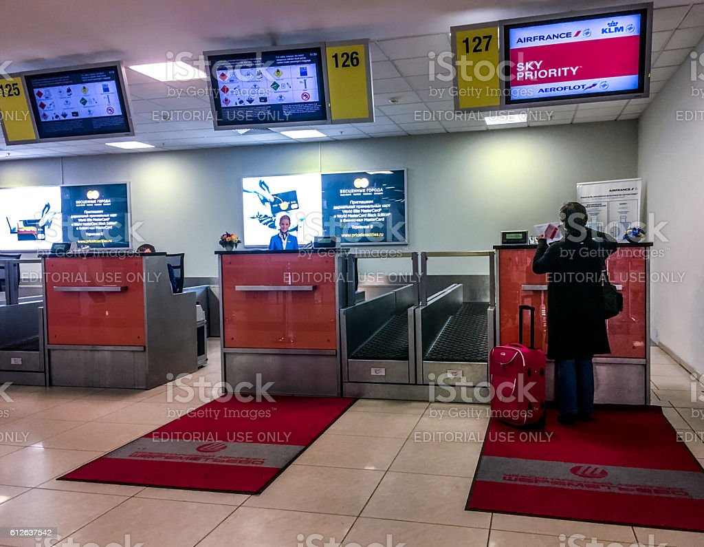 Passenger checking in at flight, Moscow Sheremetyevo Airport stock photo