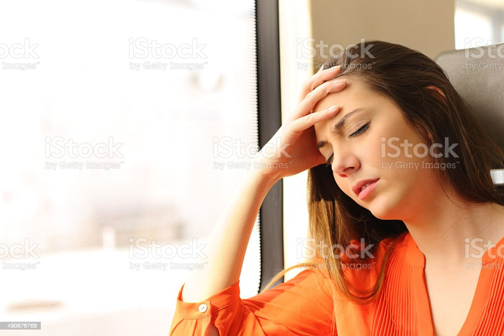 Passenger feeling dizzy in a train travel stock photo