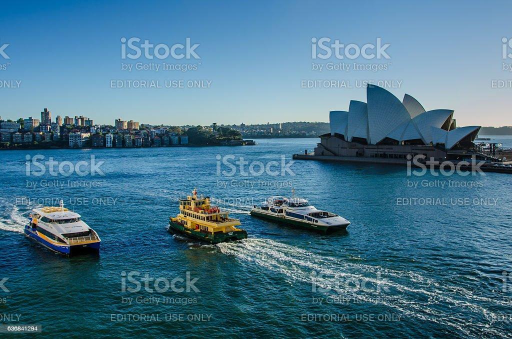 Passenger ferries sail past Sidney Opera House stock photo