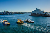 Passenger ferries sail past Sidney Opera House