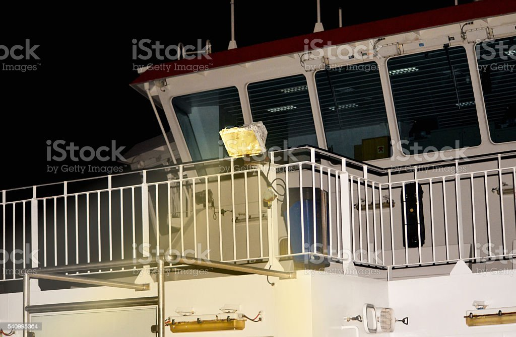 Passenger Ferry Bridge at Night stock photo