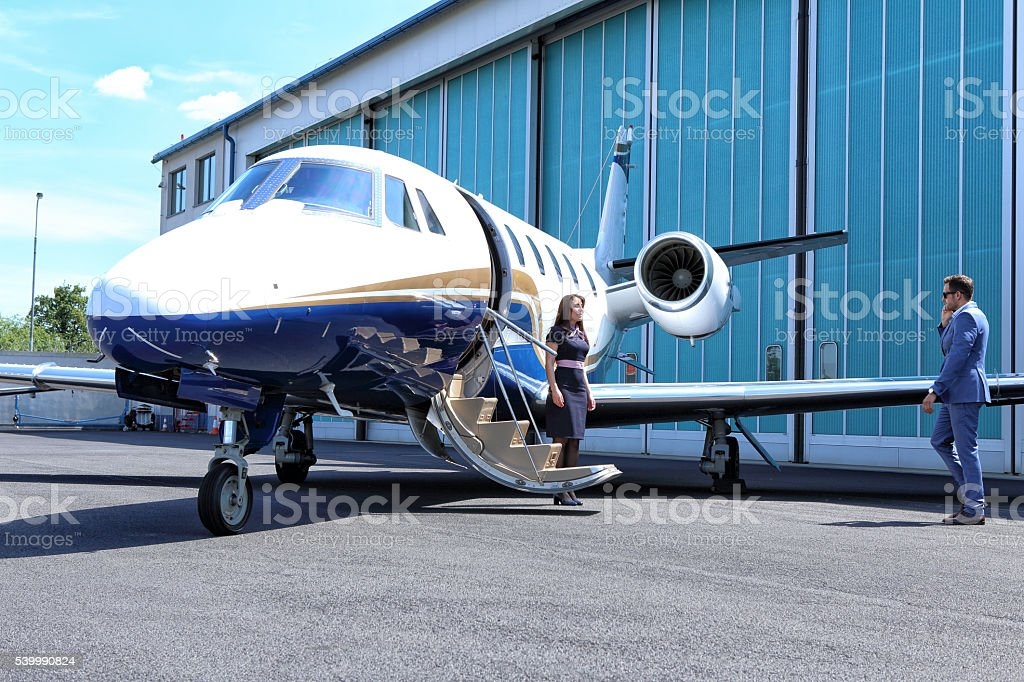 Passenger going towards the business jet stock photo