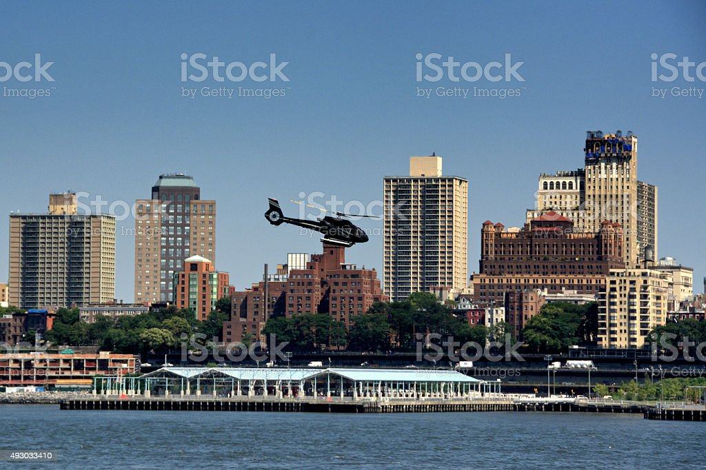 Passenger Helicopter over East River Near Brooklyn, New York City stock photo