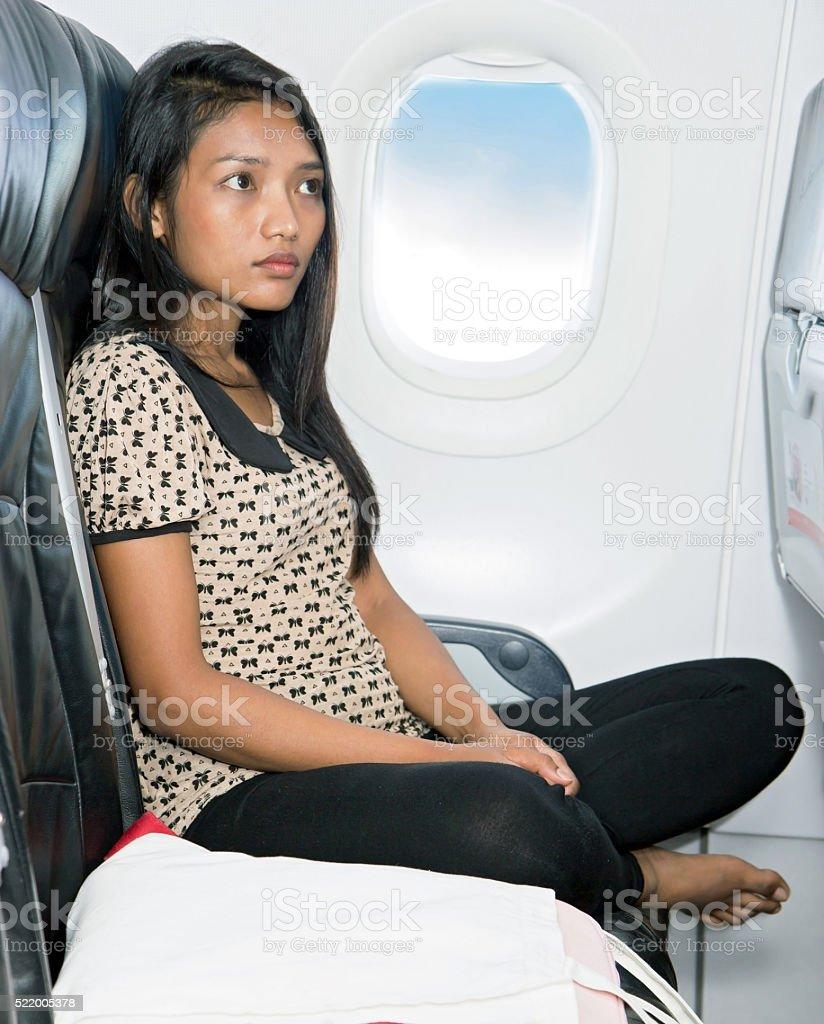 passenger in plane stock photo