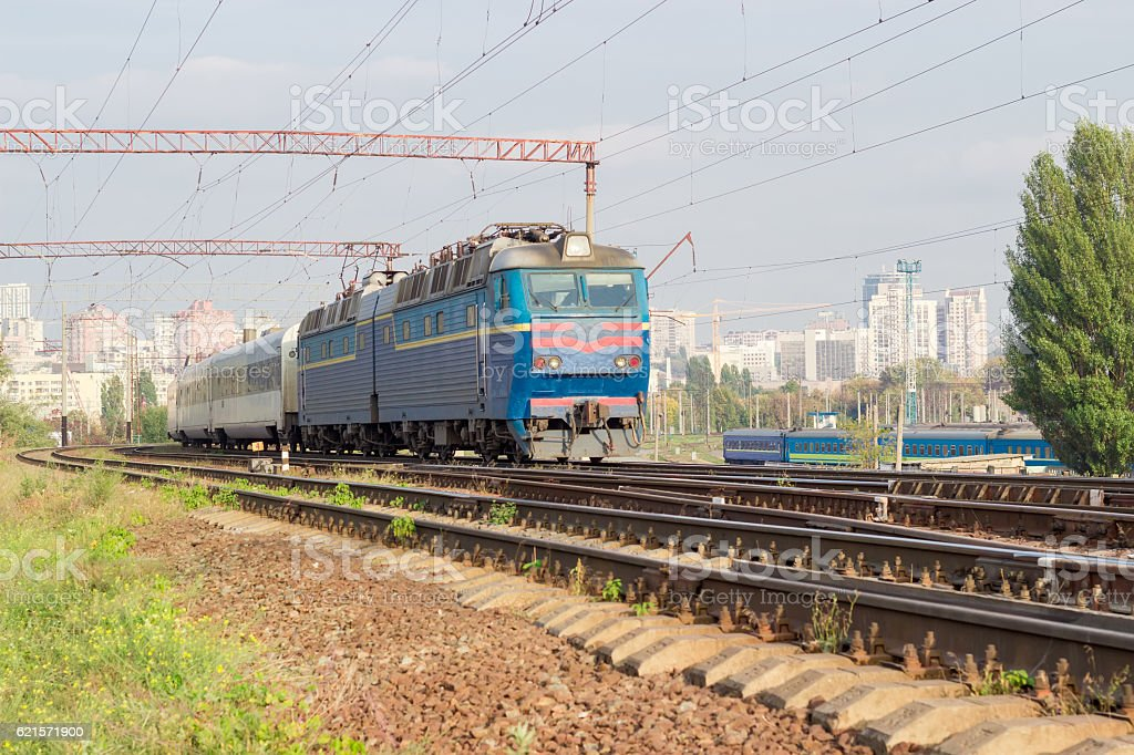 Passenger inter-city train on the background of urban developmen stock photo