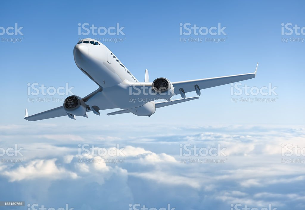 Passenger jet airplane flying above clouds stock photo