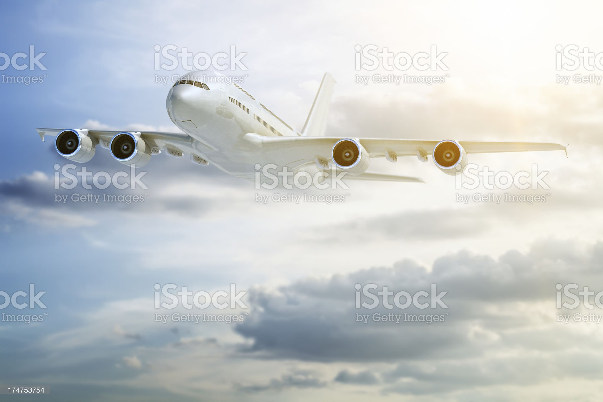 Passenger jet airplane flying in clouds royalty-free stock photo
