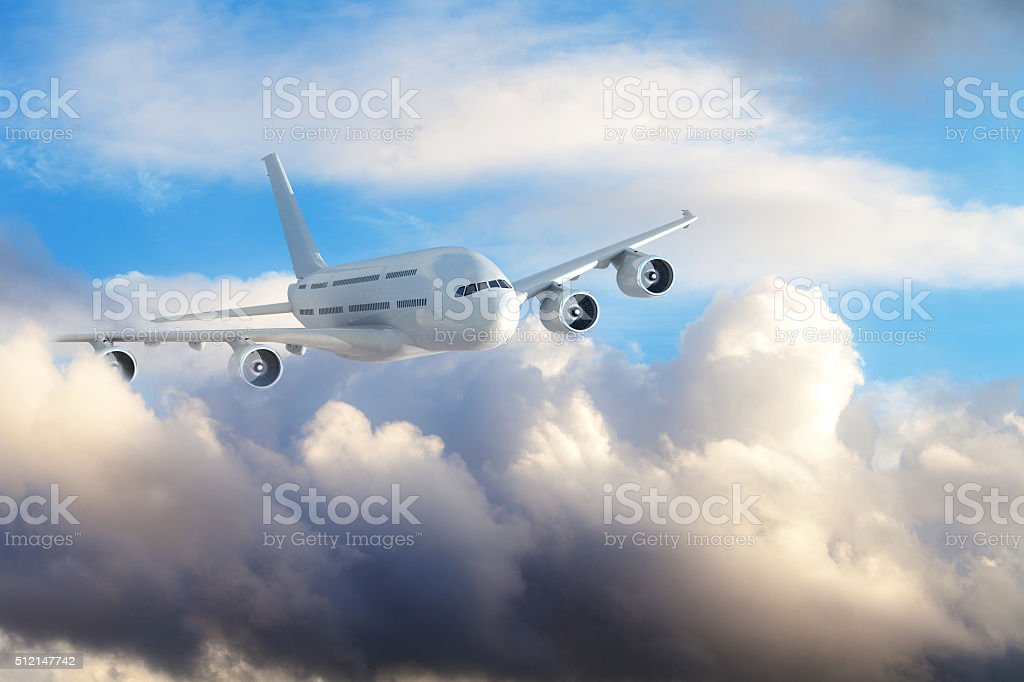 Passenger jet airplane flying in clouds stock photo