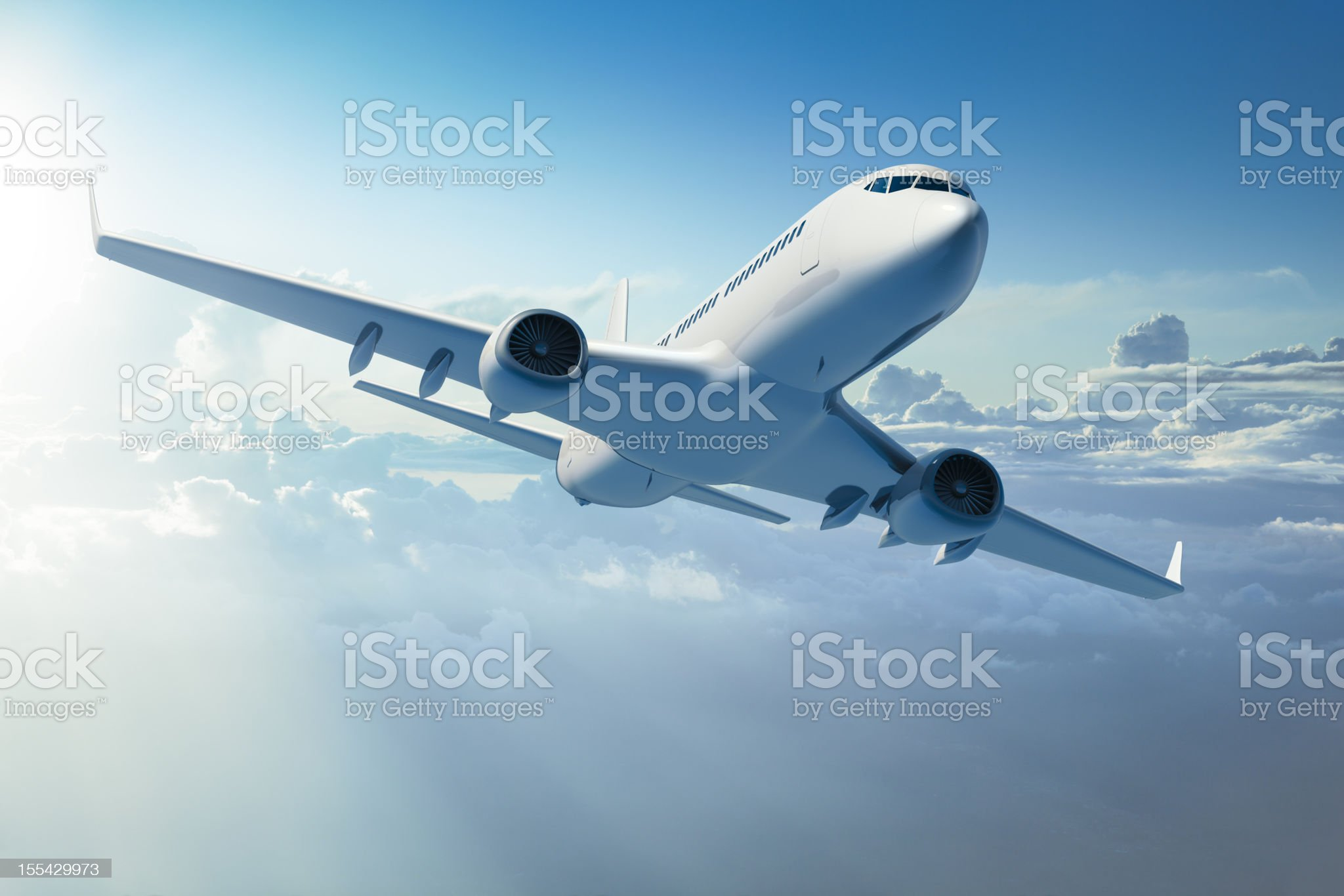 Passenger jet airplane over clouds royalty-free stock photo