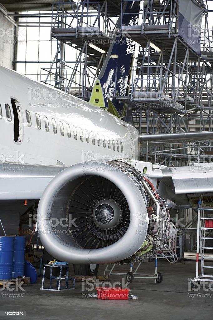 Passenger Jet During Maintenance Check in Hangar stock photo