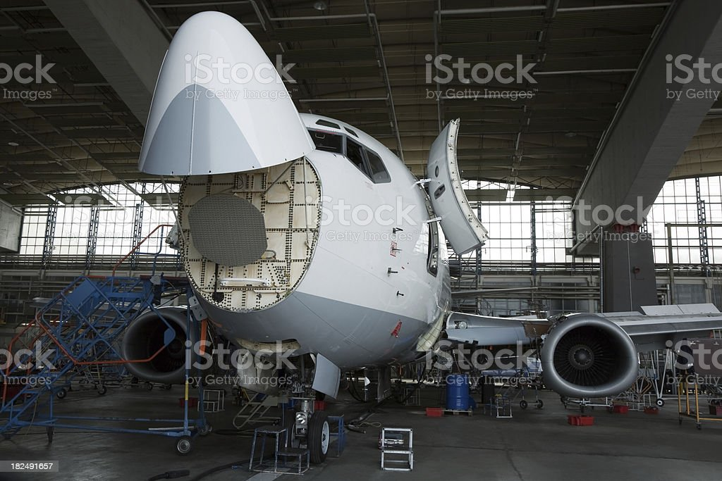 Passenger Jet Maintenance Repair and Inspection in Hangar stock photo