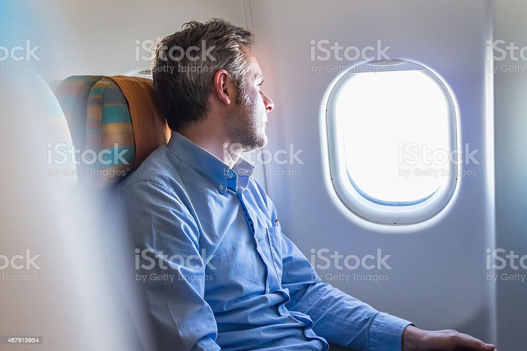 Passenger on Airplane stock photo
