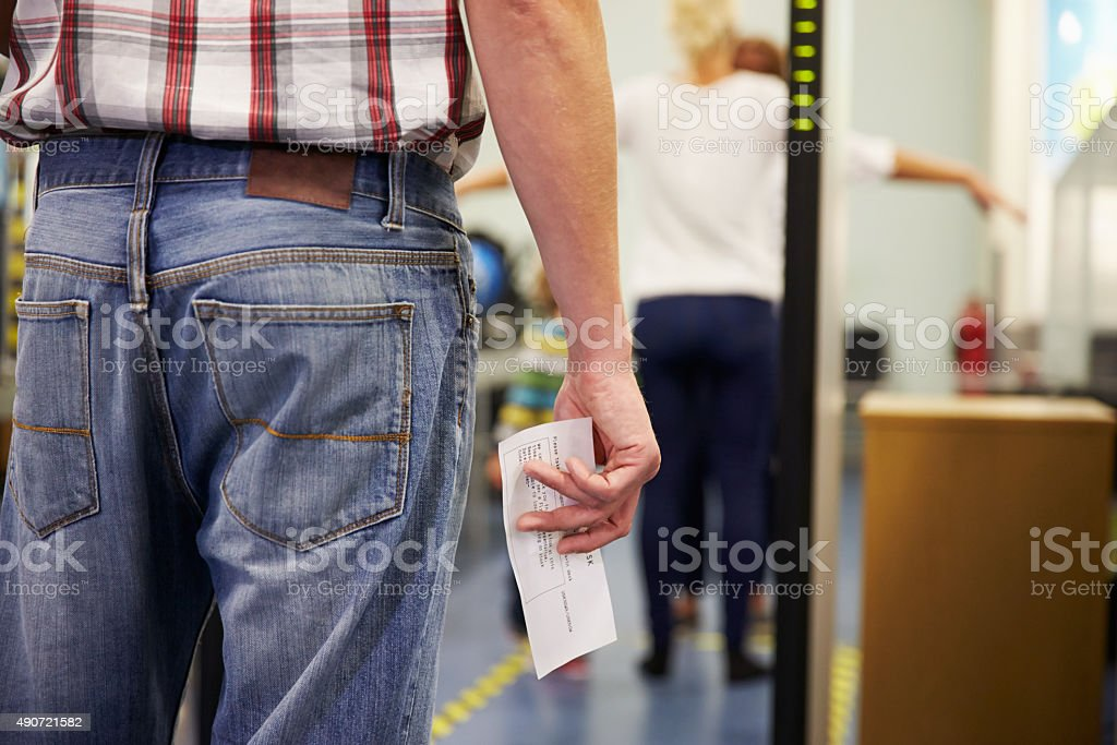 Passenger Passing Through Security Check At Airport stock photo
