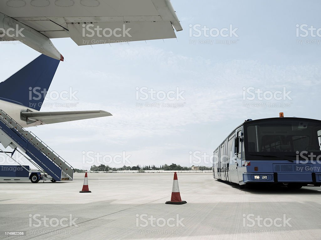 Passenger Plane and transfer bus stock photo