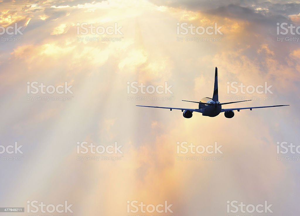 Passenger plane at sunset stock photo