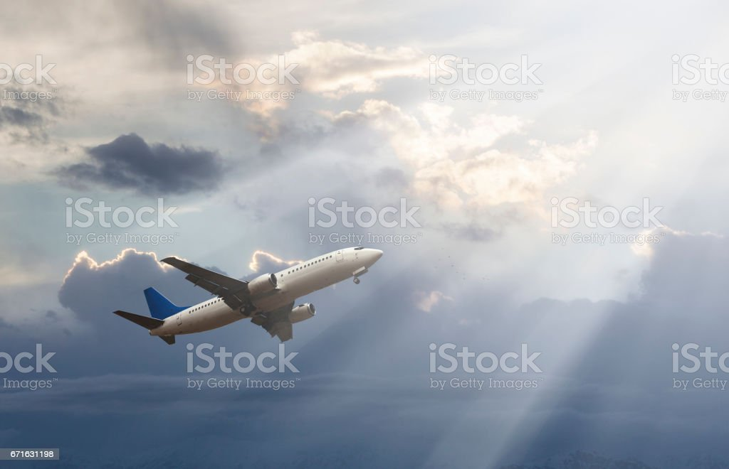 Passenger plane at sunset stock photo