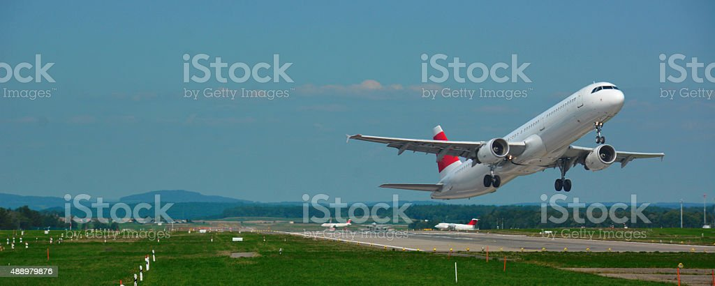 passenger plane fly up over take-off stock photo