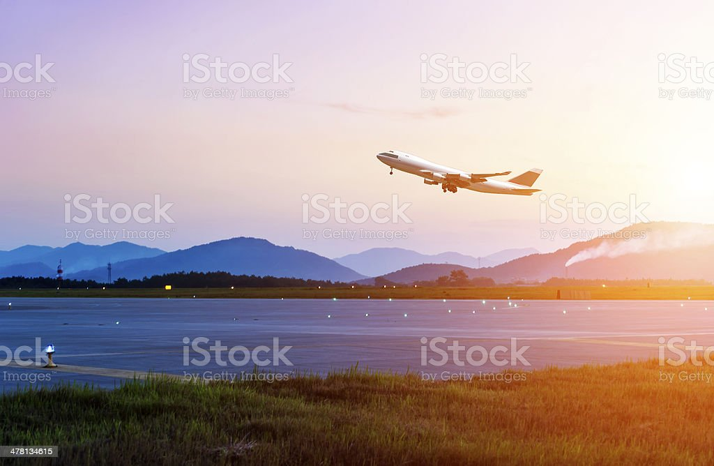 passenger plane fly up over take-off runway stock photo