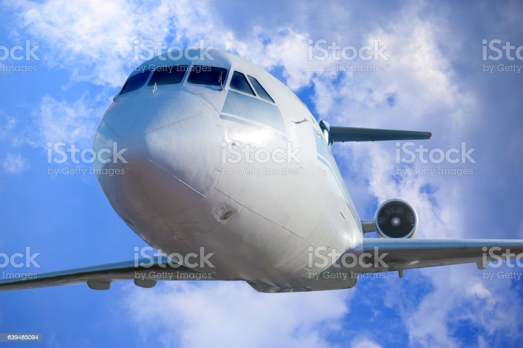 passenger plane in the blue sky stock photo
