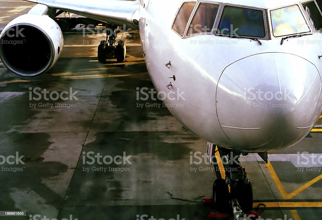 Passenger plane on runway royalty-free stock photo