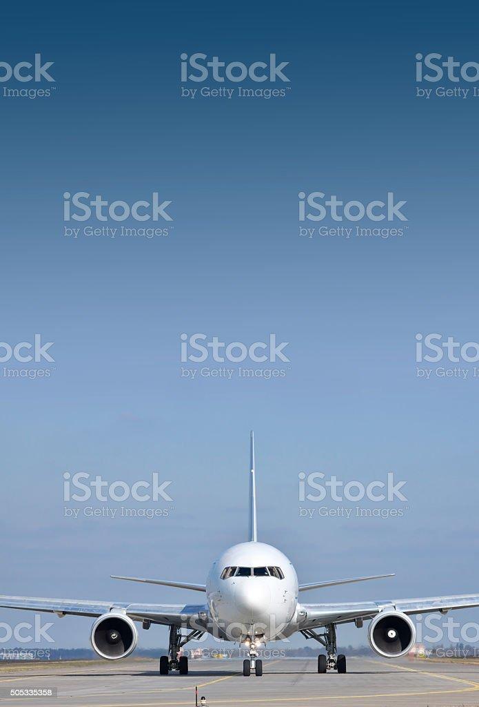 Passenger plane on runway stock photo