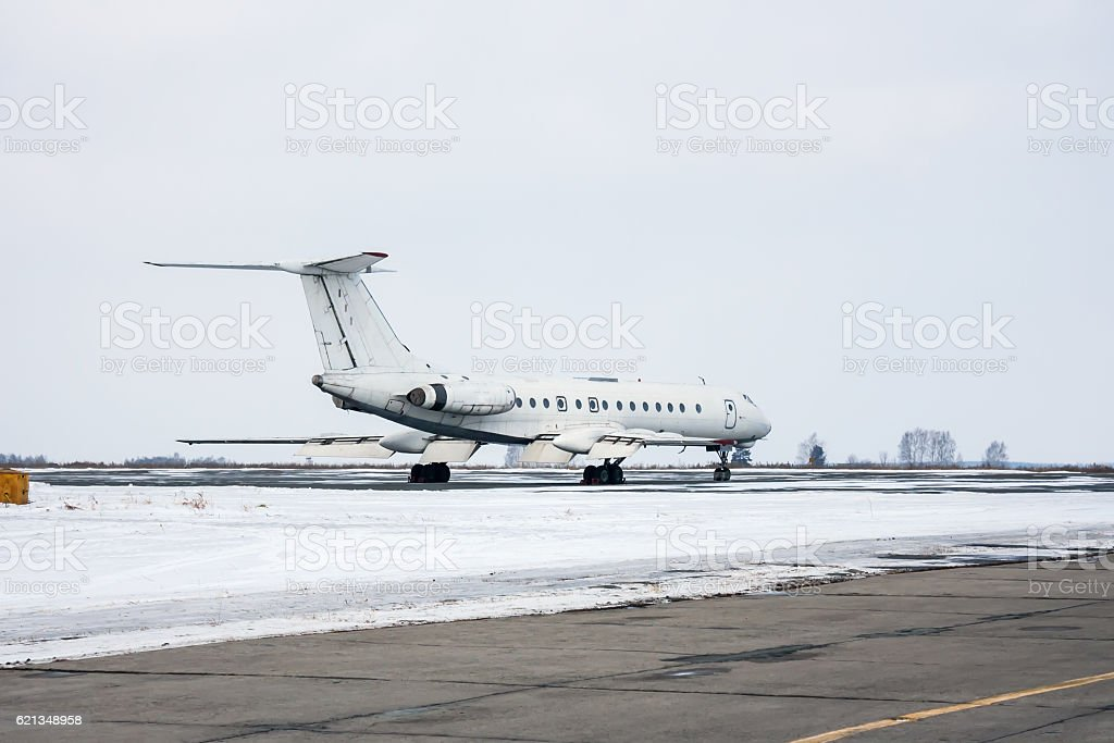 Passenger plane on the winter airport apron royalty-free stock photo