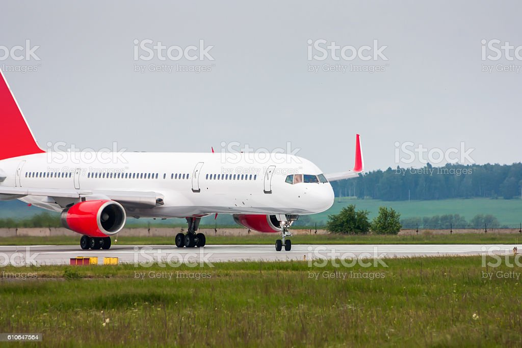 Passenger plane taxiing from the runway royalty-free stock photo