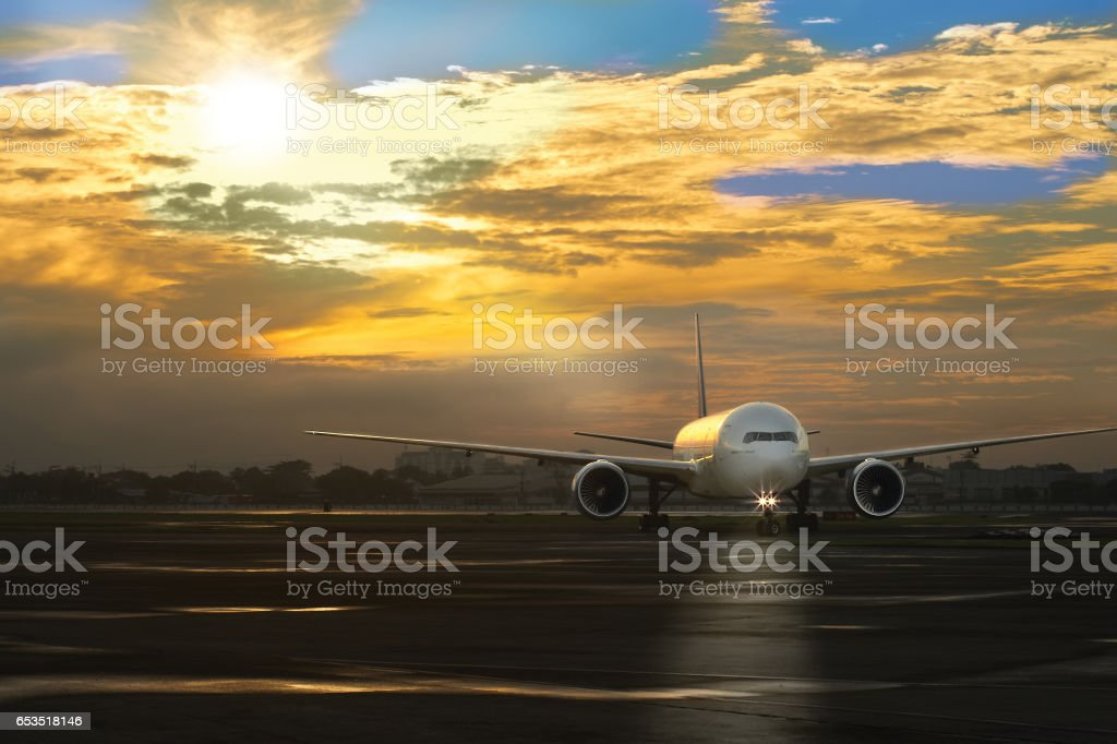 Passenger plane taxiing to the parking lot after landing stock photo