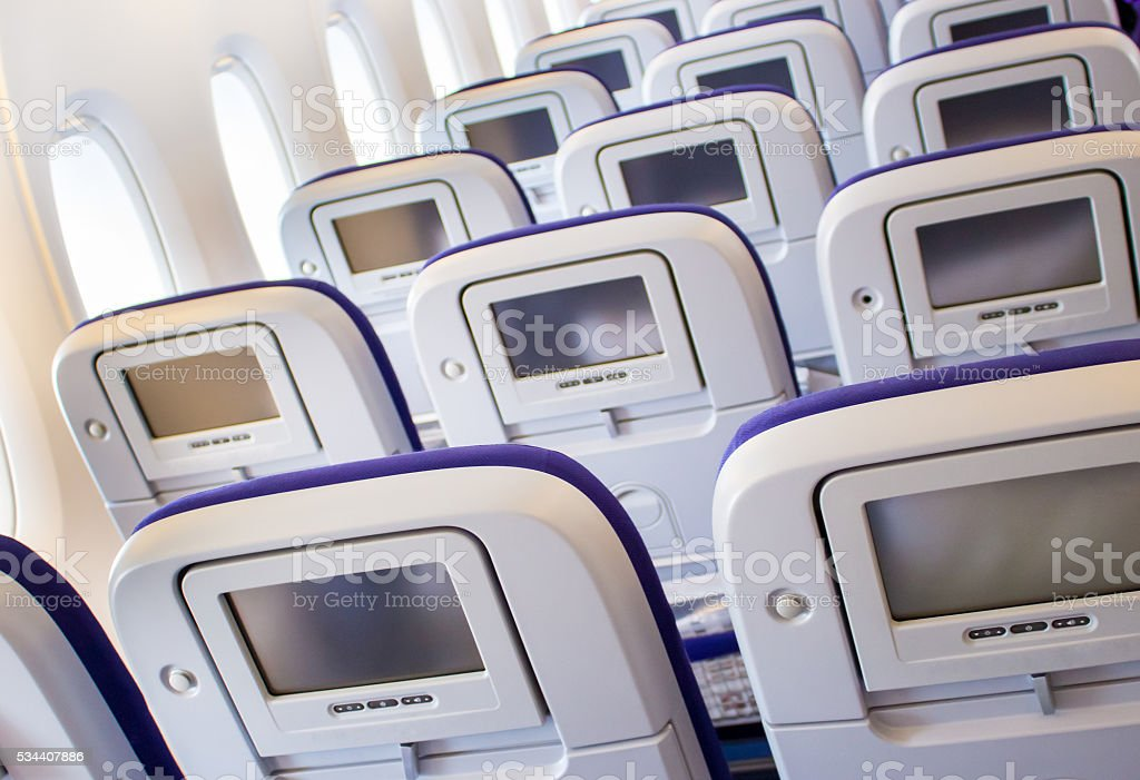 Passenger seat of plane with screen stock photo