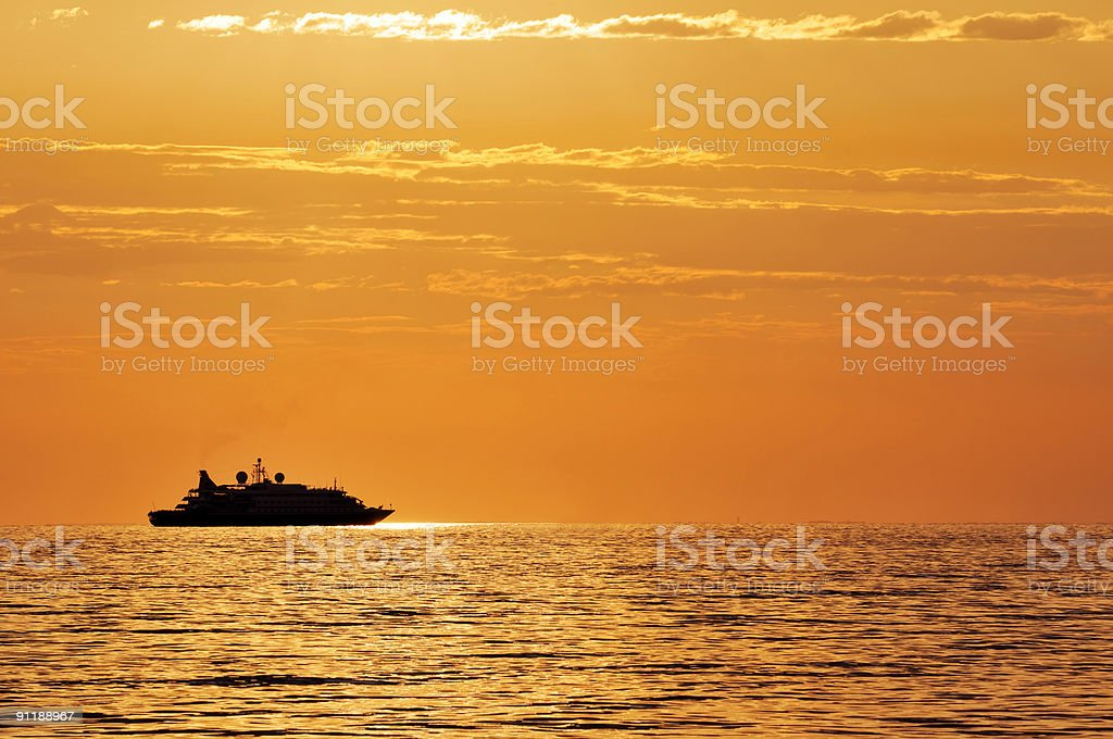 Passenger ship at sunset stock photo