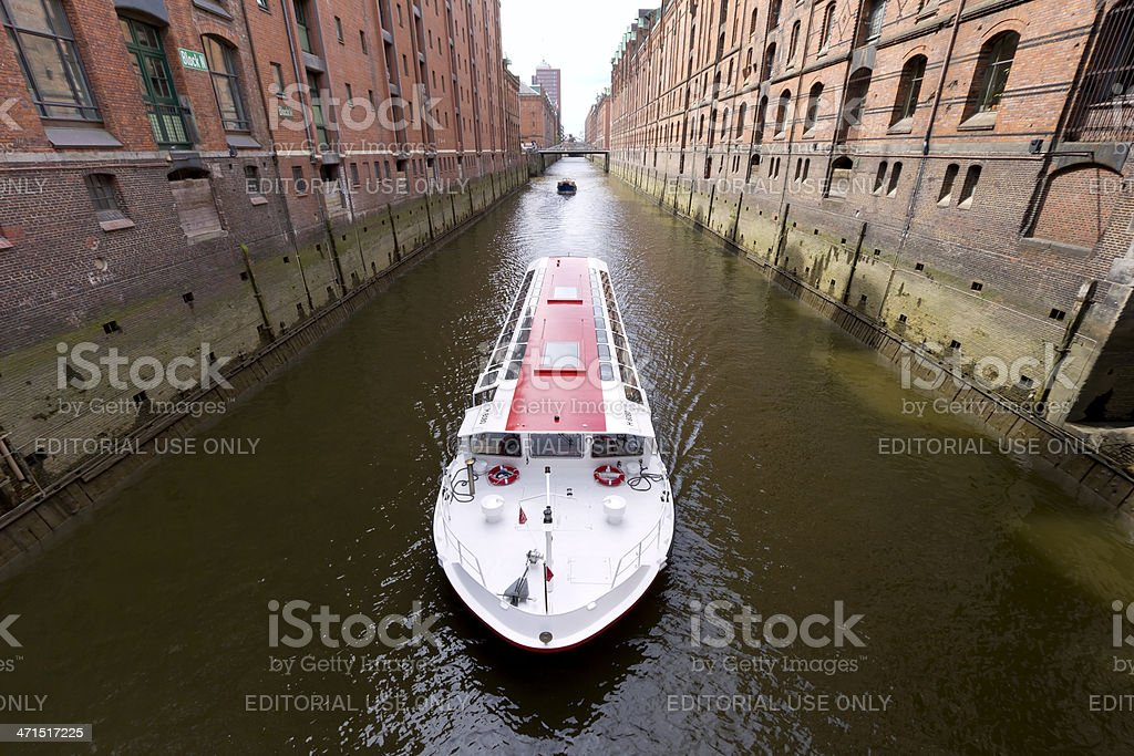 A passenger ship with tourists drives through the canals of the...