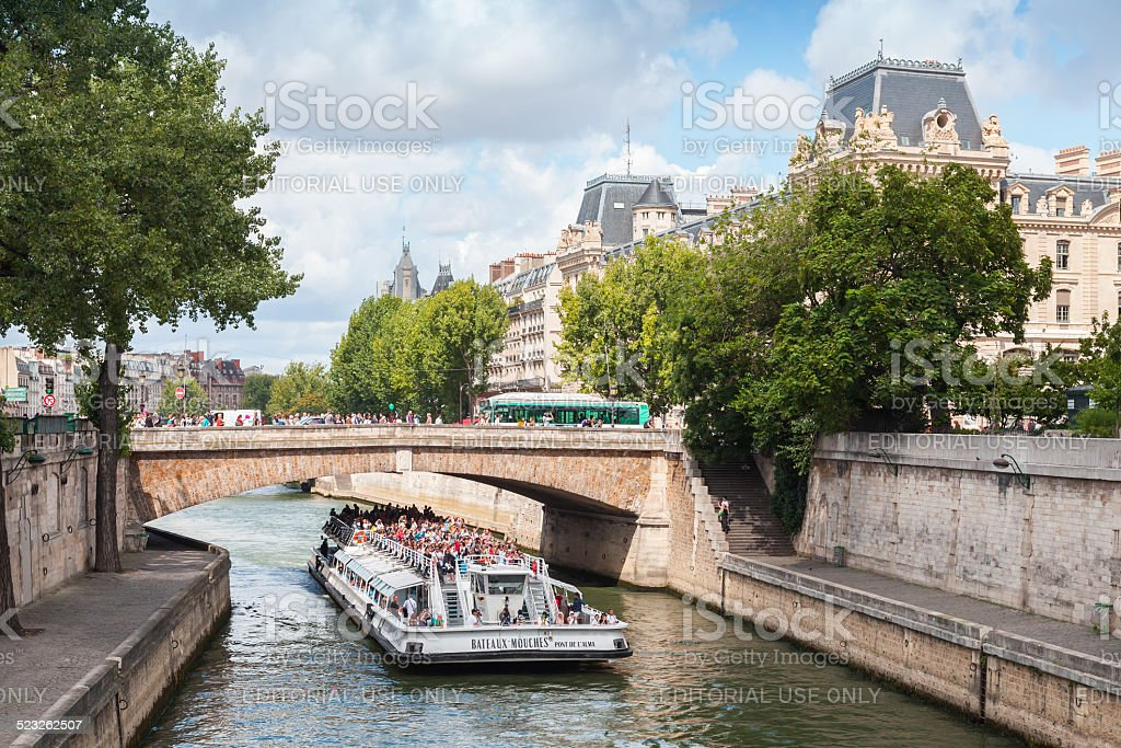 Passenger ship operated by Bateaux-Mouches on Seine river stock photo