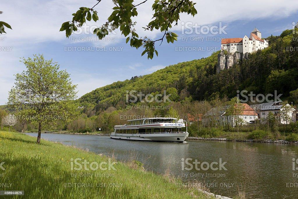 passenger ship under castle stock photo