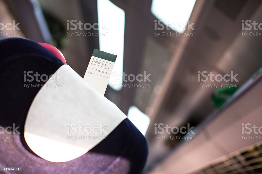 Passenger train carriage seat showing a reservation ticket. stock photo