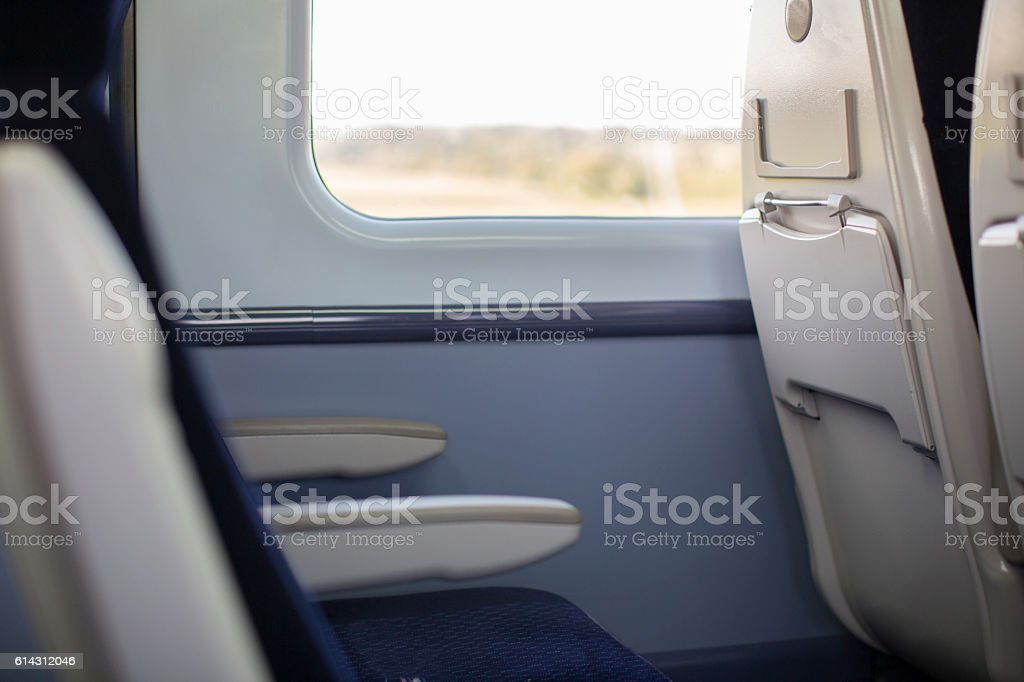 Passenger train carriage showing the rear of seat. stock photo