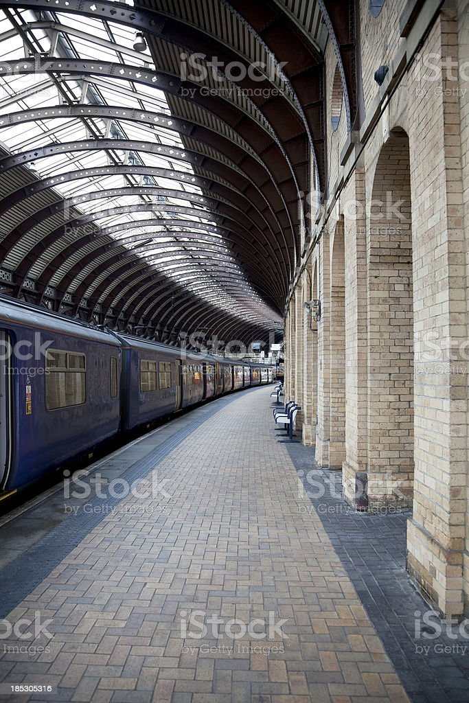Passenger train, curved platform royalty-free stock photo