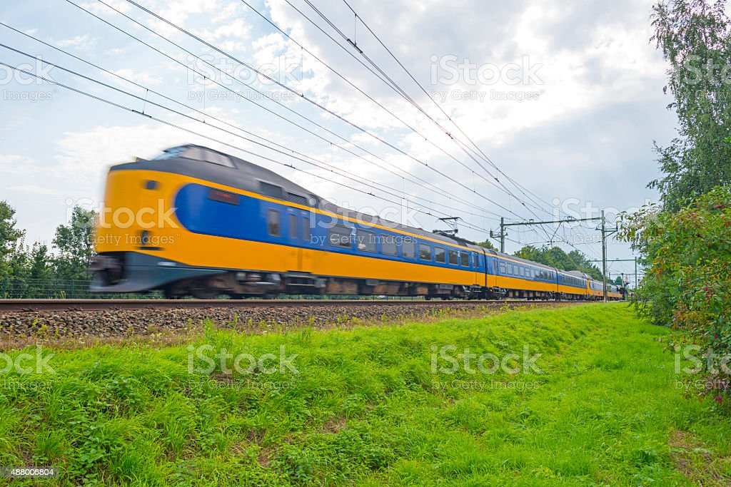 Passenger train driving at high speed stock photo