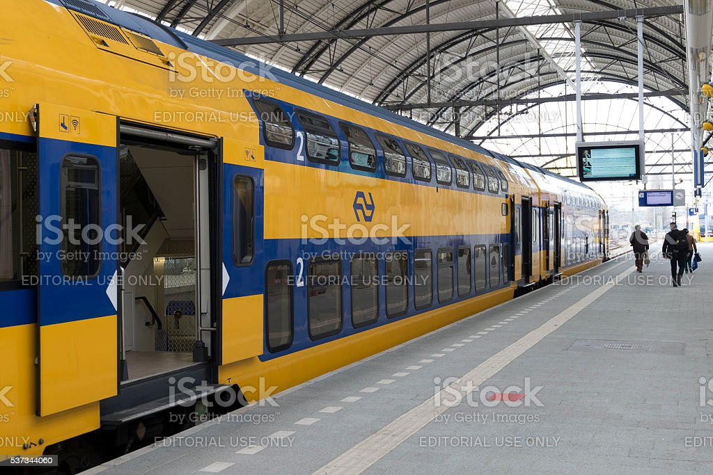 Passenger train of the Dutch Railways (NS) at Zwolle station stock photo