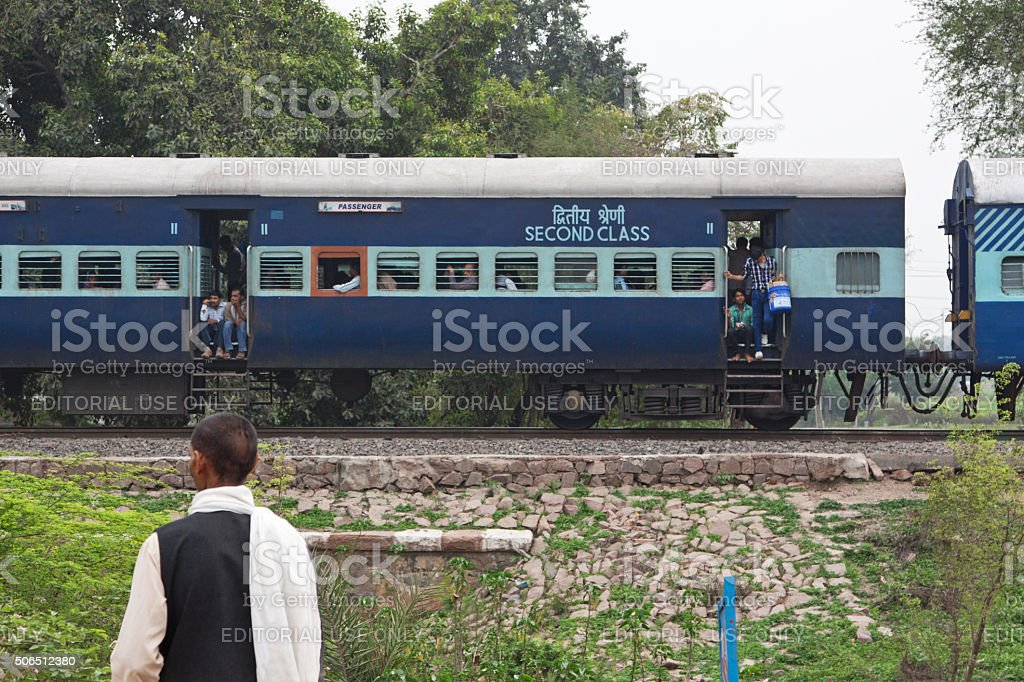 Passenger train slowing to a halt in rural India stock photo