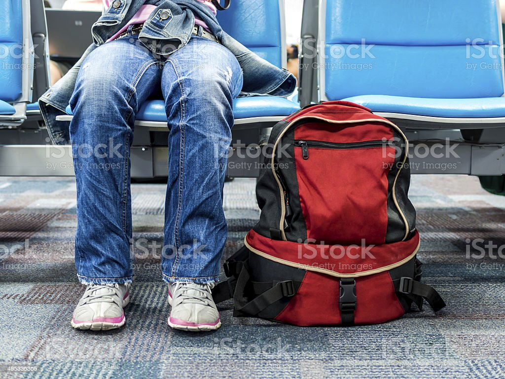 Passenger traveler woman in airport waiting for travel with backpack stock photo