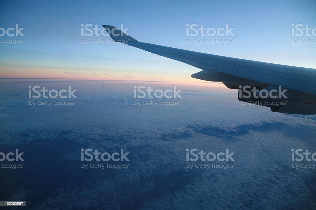 Passenger view of a jet airplane wing during flight stock photo