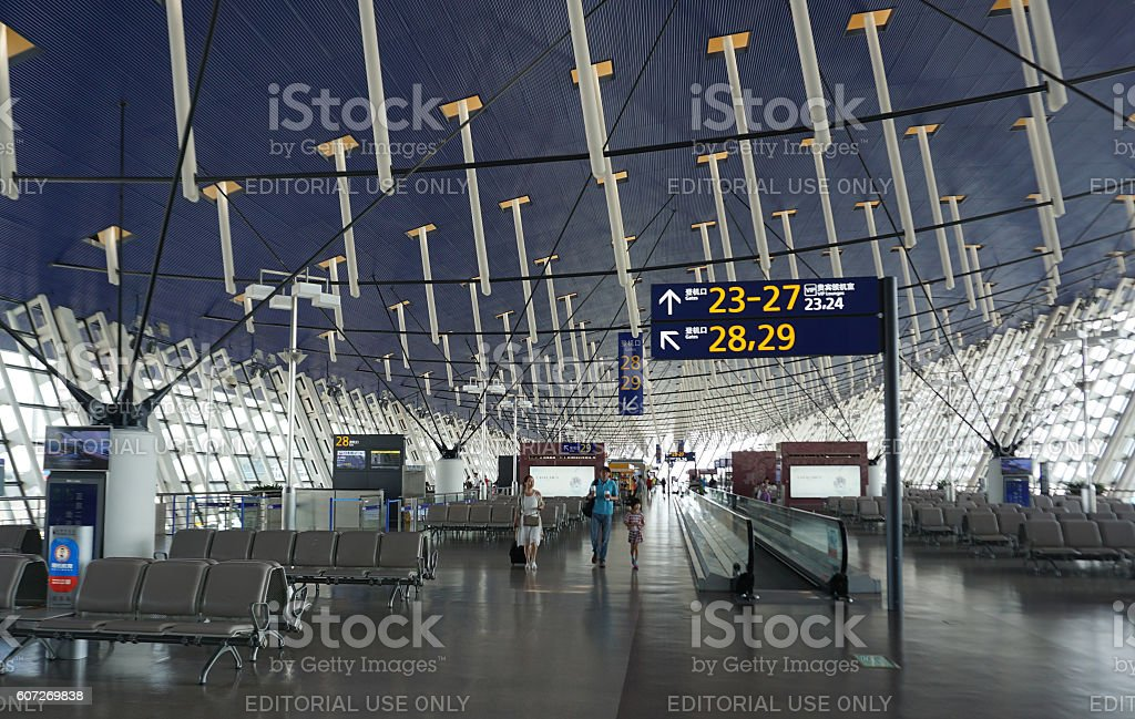 Passenger walking around Shanghai Pudong International Airport Terminal 4 stock photo